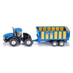 Tracteur New Holland avec remorque d'ensilage