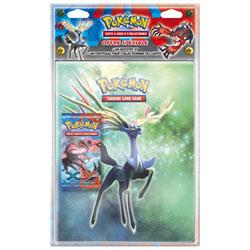 Pokémon Cahier Portfolio et un booster XY
