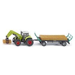 Tracteur et remorque à balles
