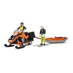 Moto neige avec traîneau de sauvetage et skieur