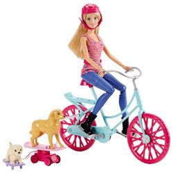 Barbie à vélo avec ses chiens