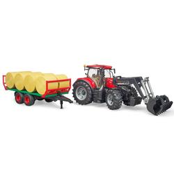 Tracteur Case IH avec fourche et remorque à balles