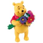 Figurine de Winnie l'ourson avec des fleurs