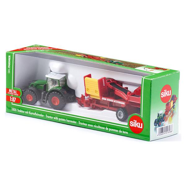 Tracteur avec récolteuse