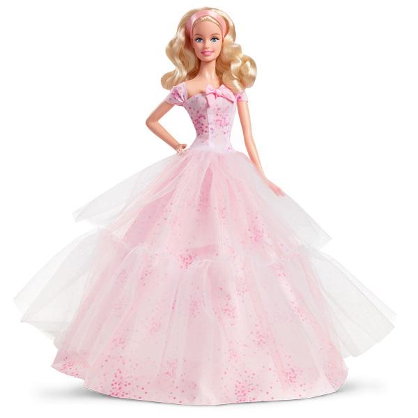 Retrouvez Barbie dans une robe ravissante pour que la fête d´anniversaire commence. Elle est vêtue d´une robe rose pâle à imprimés confettis. Un adorable nud se trouve sur le buste de la poupée, mettant en valeur une robe au style raffiné et glamour. Une