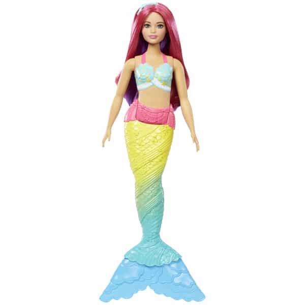 Cette Barbie sirène multicolore aux cheveux roses est prête à vous suivre afin de vivre de nombreuses aventures aquatiques. Son bustier et ses nageoires sont finement sculptés et ornementés de perles, de fleurs, de dentelles ou de rubans multicolores. Ses